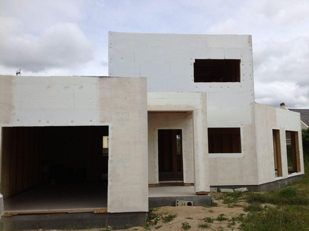 Isolation thermique sur maison ossature bois en cours de realisation